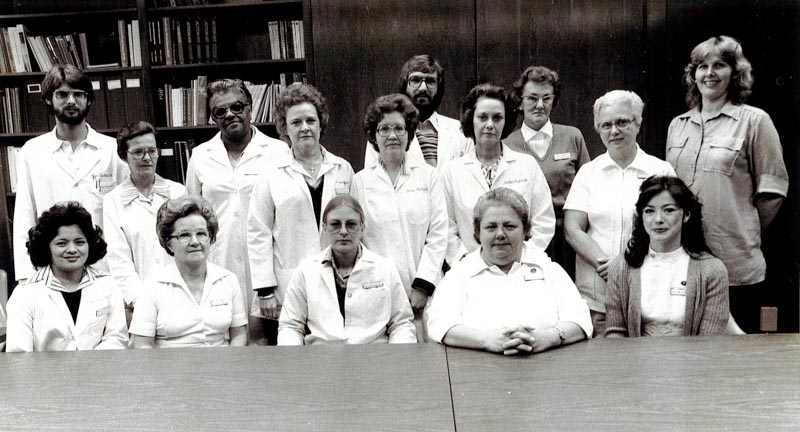 27-year-old Assistant Director of Nursing Janet Harris, front row on the far right, poses with other administrators at UMMC in the late 1970s.
