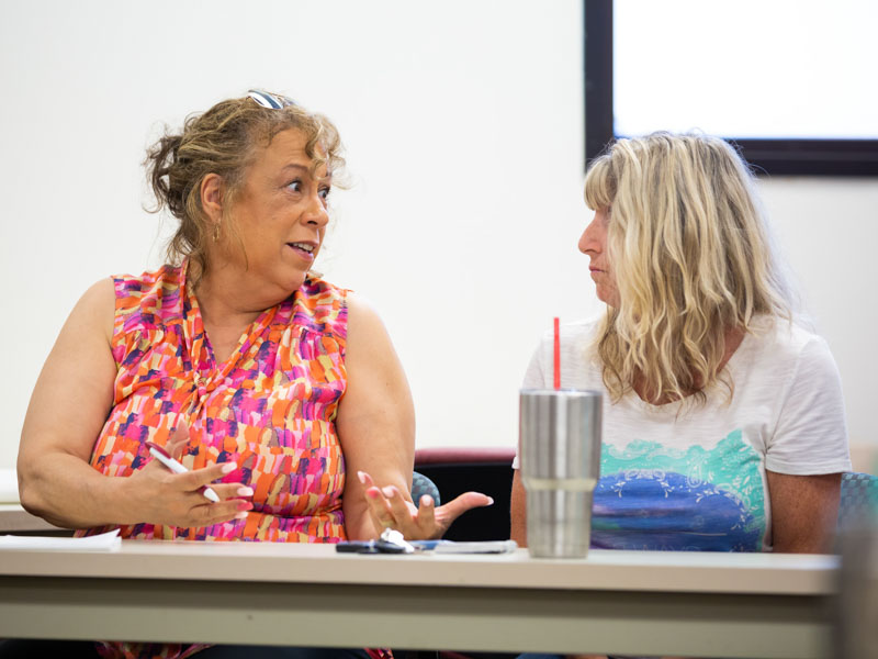Lu Williams of Jackson, left, and Lynn Hulett of Florence talk during a recent support group meeting.