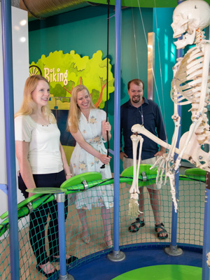 New residents Dr. Anna Beth Case, left, Dr. Alicia Snider and Dr. R.J. Case take turns pulling a rope to move the skeleton at the Boney-You exhibit in the Mississippi Children's Museum. New residents enjoyed time together at a June 27 party at the Mississippi Children's Museum.