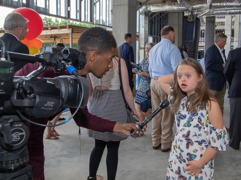 Marcus James of WJTV interviews Mississippi's 2019 Children's Miracle Network Hospitals Champion Aubrey Armstrong of Oxford before the start of the topping-out ceremony.