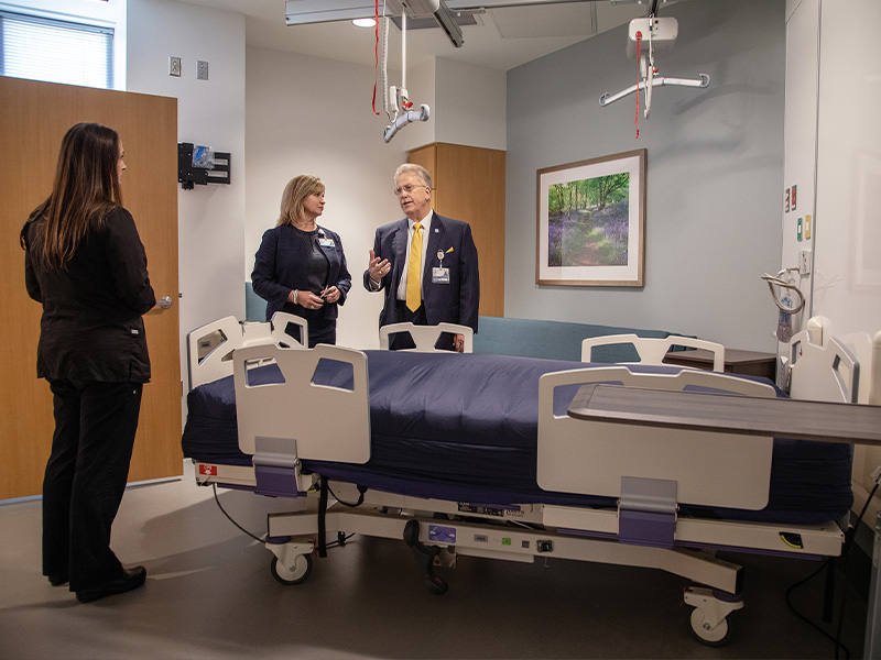 Heather Vaughn, research nurse manager for the Clinical Research and Trials Unit; Dr. LouAnn Woodward, UMMC vice chancellor for health affairs; and Dr. Gailen Marshall, medical director for the CRTU visit a patient room during the dedication of the CRTU at the University of Mississippi Medical Center.