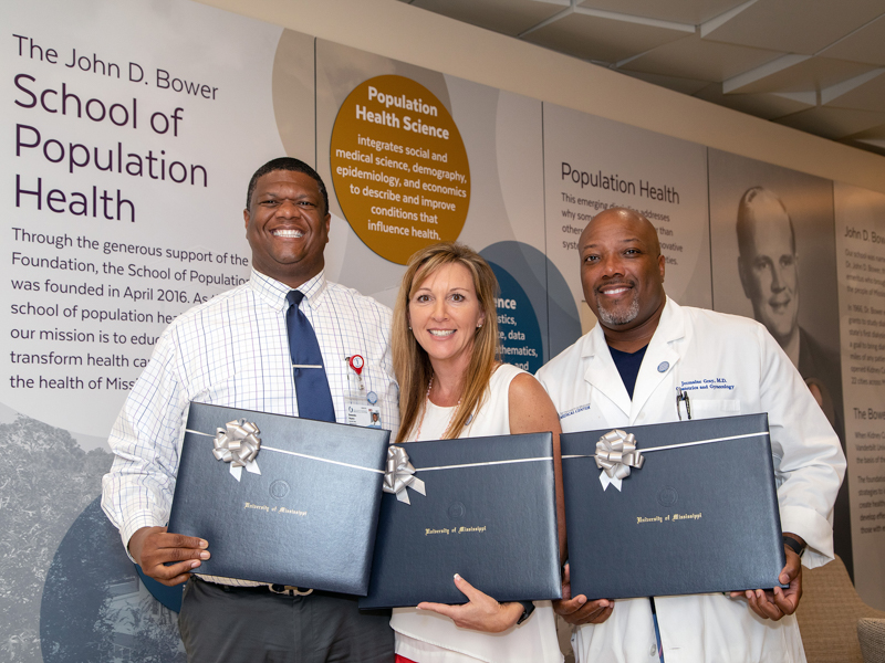 The first graduates of the executive masters in population health management program in the School of Population Health are, from left, Dr. Demondes Haynes, Lorie Ramsey and Dr. Jermaine Gray.