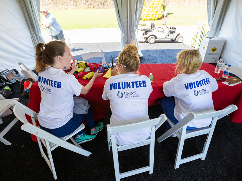 From left, Kayleigh Moore, Ashley Breeland and Chelsea Pickle, School of Nursing students, await golfers and spectators needing care at the Sanderson Farms Championship.
