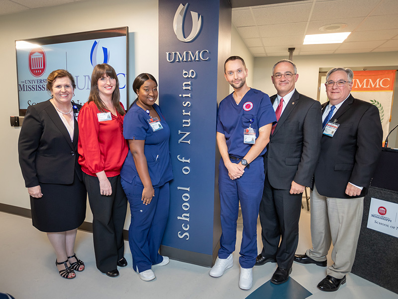 Helping to celebrate the opening of the School of Nursing Oxford's location are, from left, Dr. Julie Sanford, School of Nursing dean; Dr. Eva Tatum, SON Oxford nursing director; Hajja Bah and Chandler Craig, SON students; Larry Sparks, University of Mississippi interim chancellor; and Dr. Ralph Didlake, UMMC associate vice chancellor for academic affairs.