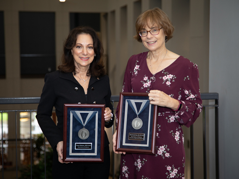 Dr. Susan Buttross, left, and Dr. Deborah Konkle-Parker received platinum medallions during the Excellence in Research Awards ceremony.