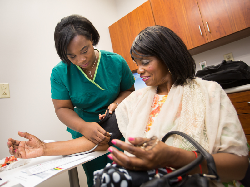 Cherrell Ball, certified medical assistant, takes Belzoni resident Sarah Ann Hood's blood pressure.