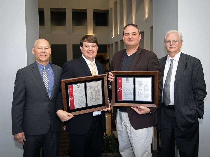 "Inventors Dr. Gene L. Bidwell and Dr. Eric M. George and their patent, ""Composition and Method for Therapeutic Agent Delivery during Pregnancy"""