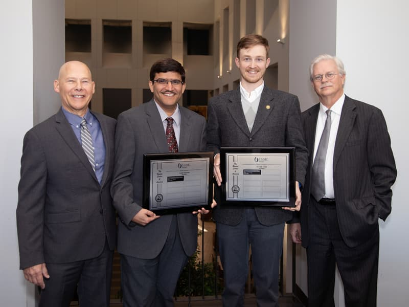 "Inventors Dr. Amol Janorkar and Jared S. Cobb with their non-provisional patent application, ""Method for the Production of Precisely Sized Macro- and Micro-ELP Containing Particles for the Delivery of Therapeutic Agents."" Dr. John Correia and Dr. Valeria Zai-Rose, not present, are co-inventors."