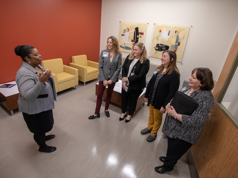 Dr. Lori Ward, left, assistant professor in the SOPH, gives a tour of the school to Dr. Jennifer Reneker, Laura Guy, Carley Dear and Dr. Mitzi Norris.