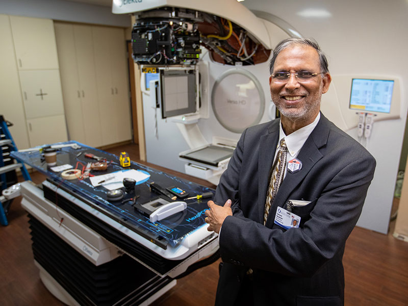 Dr. Srinivasan Vijayakumar, who leads the UMMC Department of Radiation Oncology, as a penchant for working to update processes or equipment that enhance cancer care. He's standing by a new Eleka Versa HD linear accelerator that currently is being installed.
