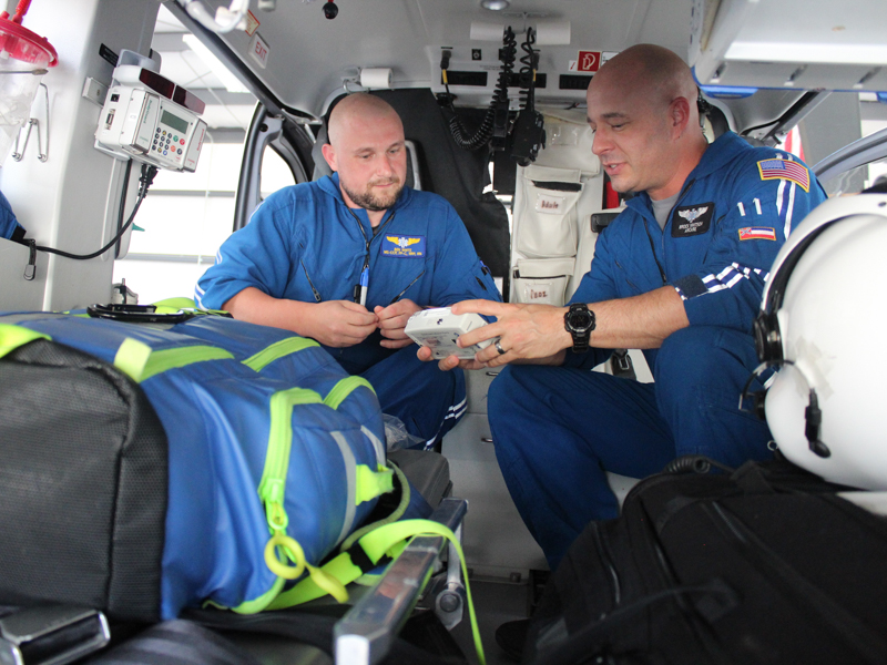 AirCare 2 flight paramedic Ben White and critical care registered nurse Brock Whitson check equipment before transporting a patient. Bill Graham/The Meridian Star