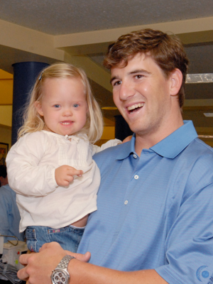 New York Giants quarterback Eli Manning is shown holding Aubrey Armstrong during a visit to Batson Children's Hospital in 2008.