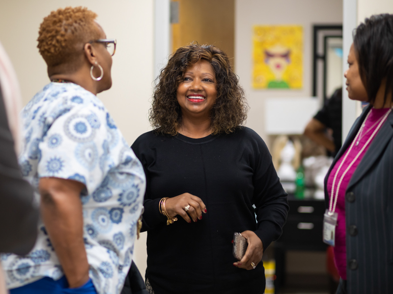 Cynthia Lewis, center, a UMMC cancer patient, shares a laugh with Janice Johnson, left, and Cassie King.