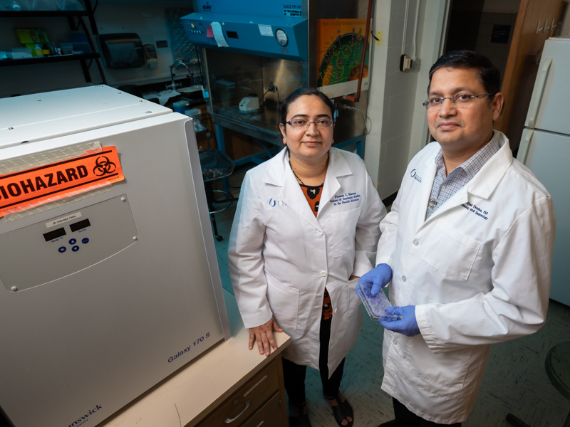 Dr. Ritesh Tandon, right, UMMC associate professor of microbiology and immunology, and Poonam Sharma, a UMMC Ph.D. student, will be studying the effects of space radiation on human cytomegalovirus.