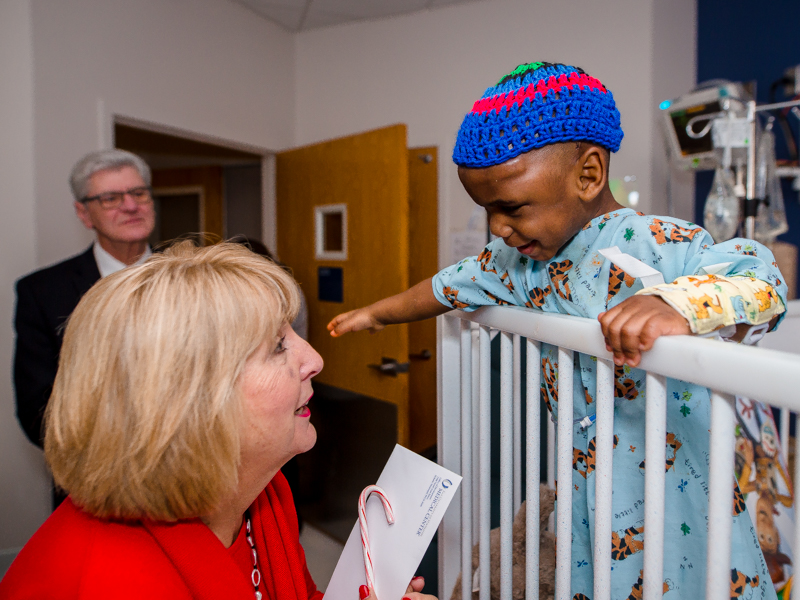 Children's of Mississippi patient Ayden Johnson of Pulaski visits with First Lady Deborah Bryant as Gov. Phil Bryant looks on.