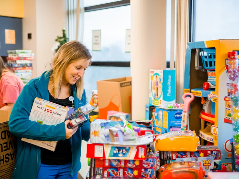 Child Life specialist Tiffany Key sorts toys donated to Children's of Mississippi patients, helping make the season bright.