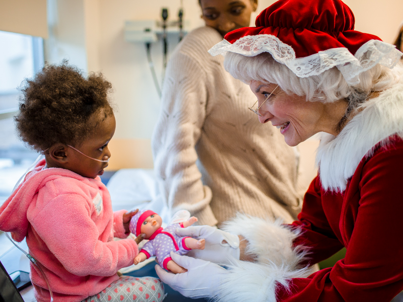 Liberty Edwards of Cleveland gets a doll from Mrs. Claus during a visit to Children's of Mississippi's Eli Manning Clinics for Children.