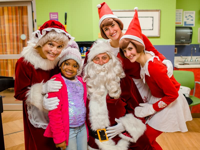 Braylee Jennings was surprised by Mrs. Claus, Santa Claus and the elves at Children's of Mississippi.