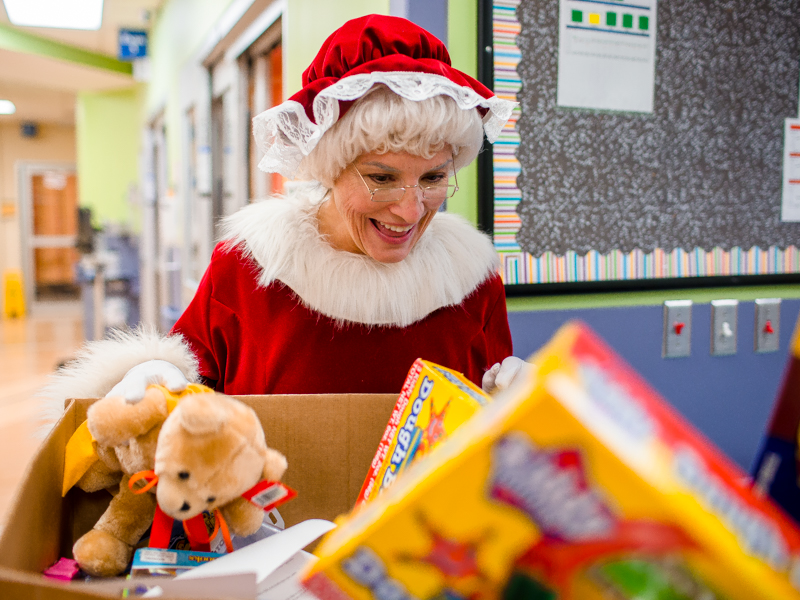 Mrs. Claus marvels over the many toys that were donated to Children's of Mississippi by the community this year.