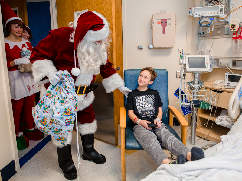 Children's of Mississippi patient Ty Foster of Sumrall gets a surprise visit from Santa Claus.