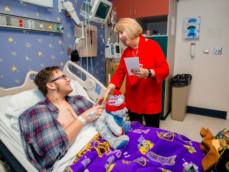First Lady Deborah Bryant surprises Children's of Mississippi patient Cooper Williams of Woodville Monday.
