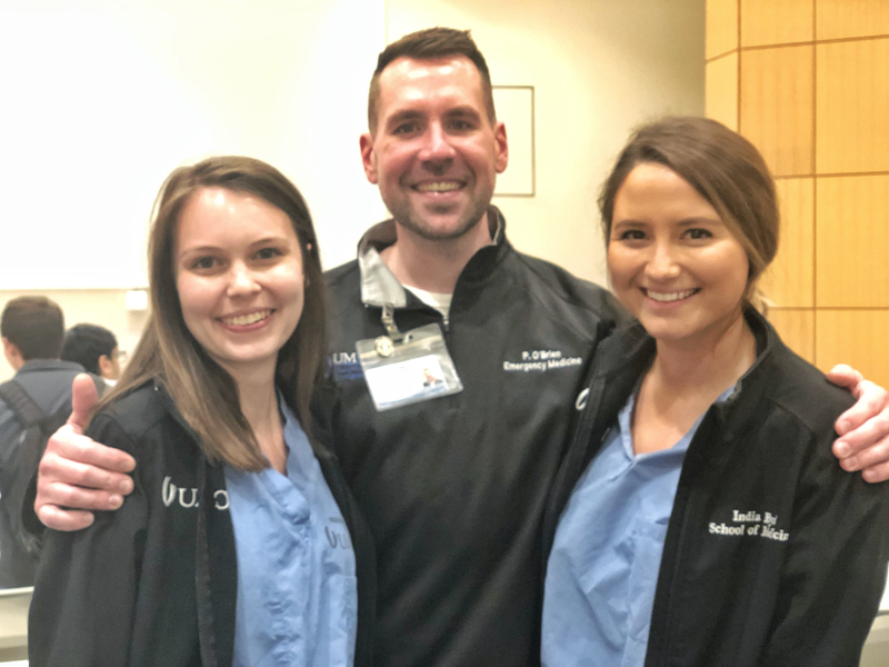 At UMMC, Patrick O'Brien has discovered several of his former high school students working or studying here, including Lexi Griffith, left, and India Byrd Hemphill, right.