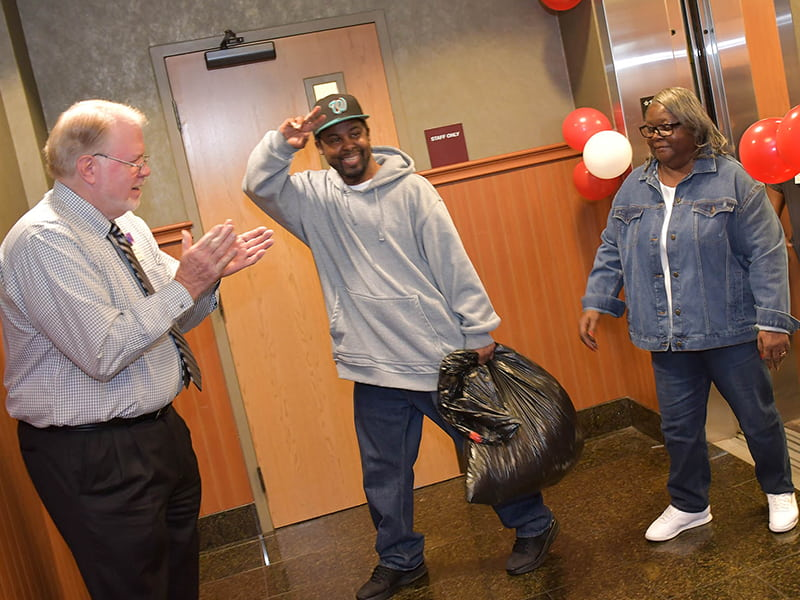 Larry McKnight, vice president of long-term care for Methodist Rehabilitation Center in Flowood, was among a crowd of well-wishers who greeted Michael Jordan and his mother, Mary Jordan, as they prepared to leave Methodist Specialty Care Center. Photo by Carey Miller/Methodist Rehabilitation Center