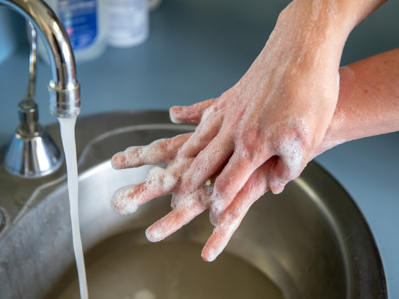 Washing hands in soap in water