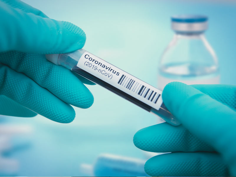 Hands holding coronavirus tube. Stock art from Getty Images.