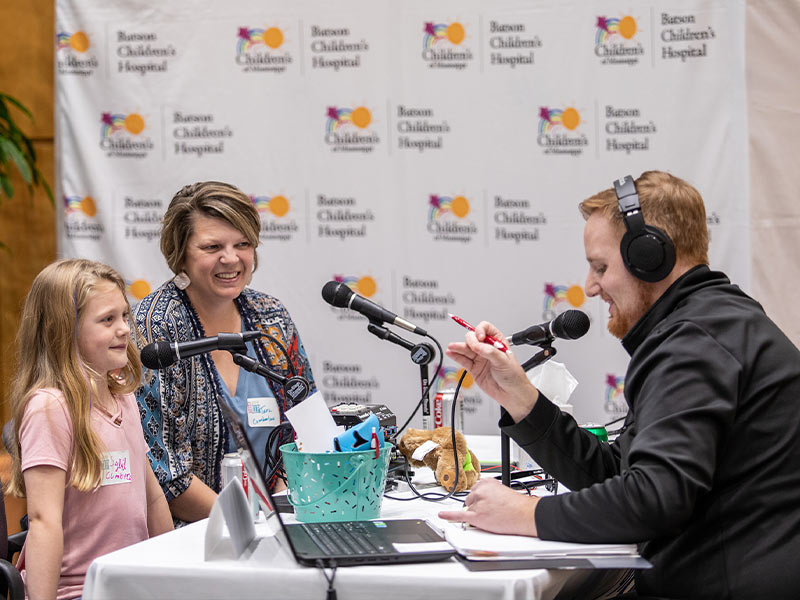 Q101's Ryan Johnson interviews Children's of Mississippi patient and this year's Children's Miracle Network Hospitals Champion Sybil Cumberland and her mom, Tara Cumberland of Preston.