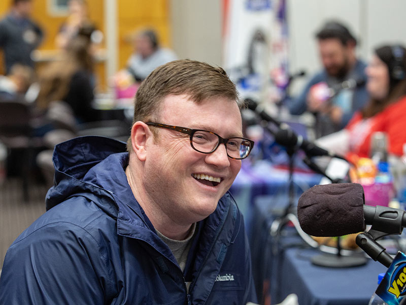 Dr. Brad Ingram, associate professor of pediatric neurology and director of the Pediatric Comprehensive Epilepsy Program at Children's of Mississippi, speaks on air during this year's Mississippi Miracles Radiothon.