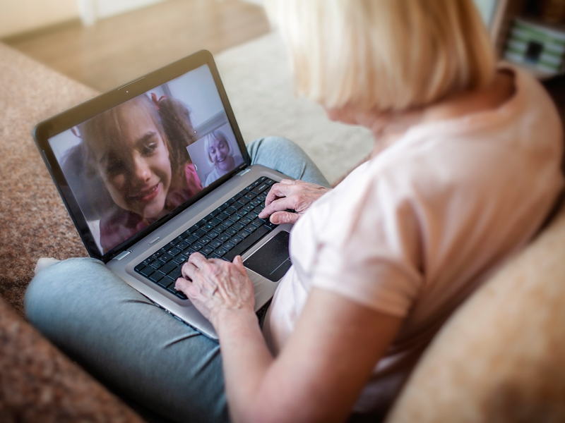 Social distancing doesn't have to mean losing contact with loved ones. Experts recommend using FaceTime and other technology to check in with friends and family during the pandemic. Photo copyright Getty Images.