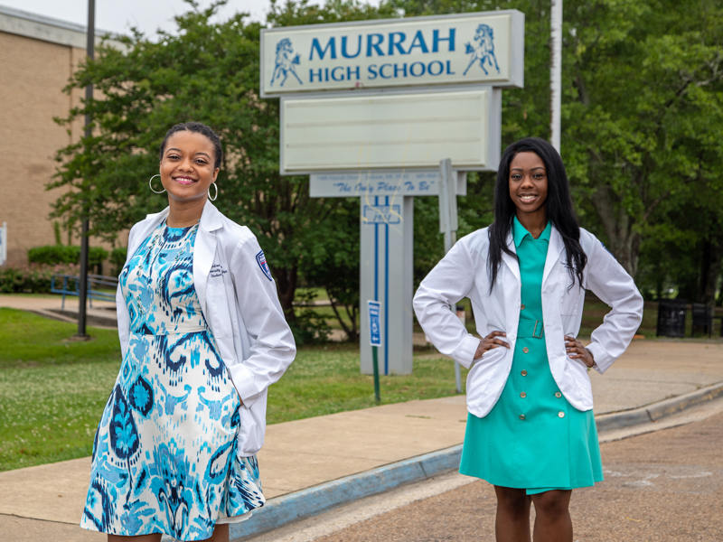 School of Pharmacy graduates Andrea Washington, left, and Brianca Fizer visit the place where their career goals began - Murrah High School.