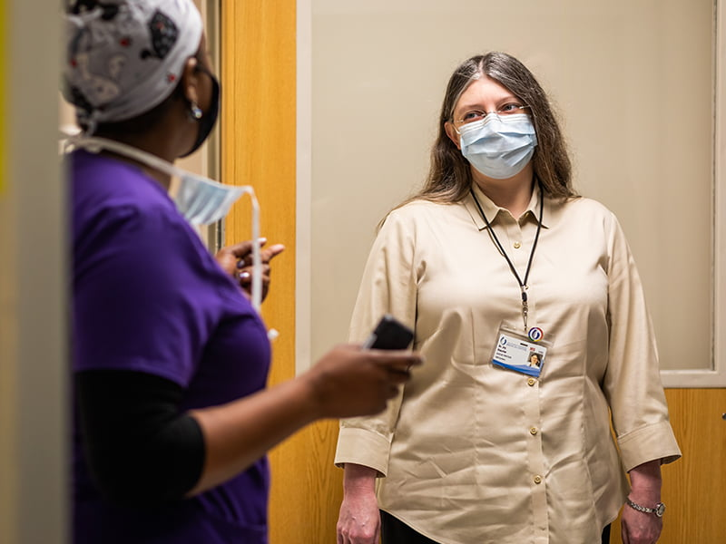 Dr. Joy Houston, right, prepares to see patients in the Adult Emergency Department in coordination with Tomika McLaurin, nurse.