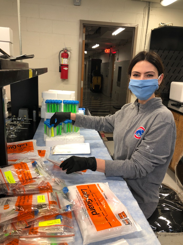 Wier volunteers in the Department of Microbiology and Immunology making test collection kits as part of the ongoing COVID-19 response.