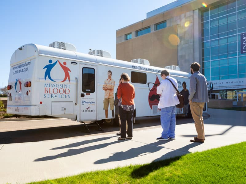 Mississippi Blood Services is working with UMMC to collect blood plasma donations from approved participants for the COVID-19 study. Here, the MBS Donor Coach parked outside the School of Medicine in 2019.