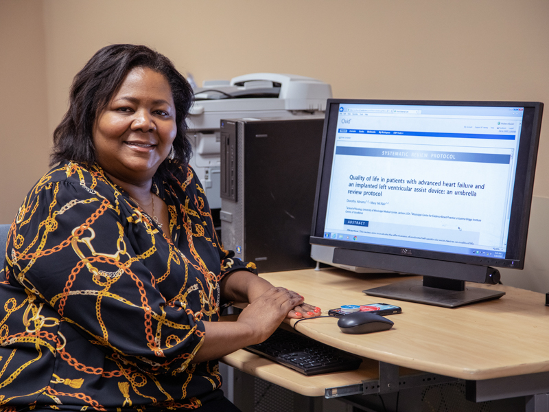 Dorothy Aultman-Abrams, a student in the Doctor of Nursing Practice Program, uses the Cochrane database in her office.