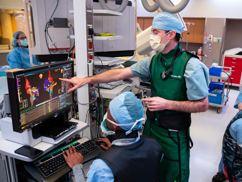 "At University Heart, Dr. James ""Mike"" Bensler, center, with, from left, Jennifer Haseloff, R.N.; Quentin Greathree, a Jackson-based member of Abbott Laboratories' support staff; Andrew Fisher, a cardiovascular interventional technologist; and Evan Byas, R.N., prepare for a procedure on one of the three dozen or so patients Bensler and his colleague Dr. James Hamilton see each day."