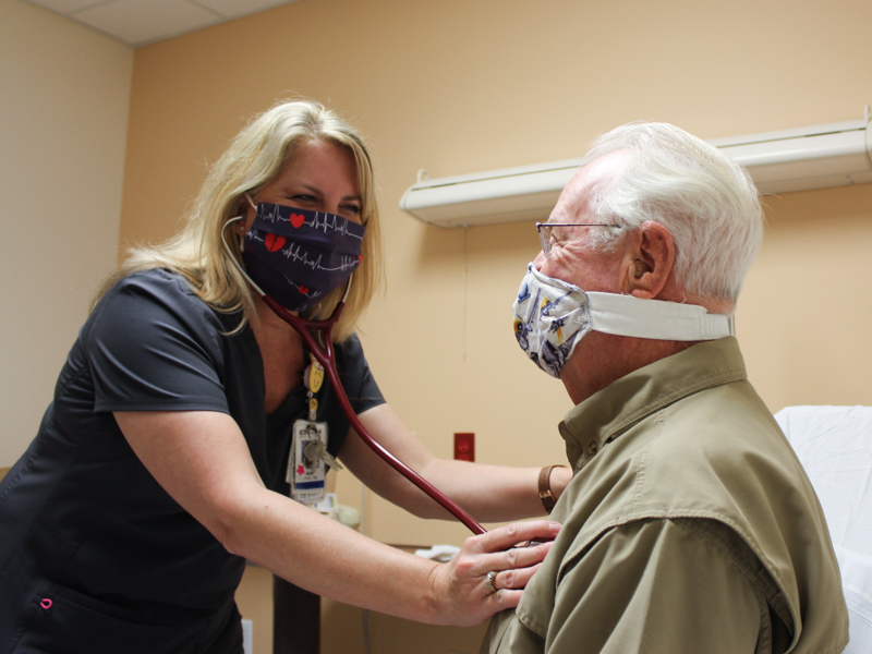Oktibbeha County Hospital registered nurse Amy White listens to the heart of OCH patient John Orton.
