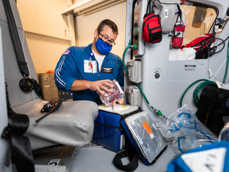 Brad Harper, flight paramedic, stocks blood and blood products on board AirCare 1 as it waits at the Mississippi Center for Emergency Services to be dispatched on its next call.