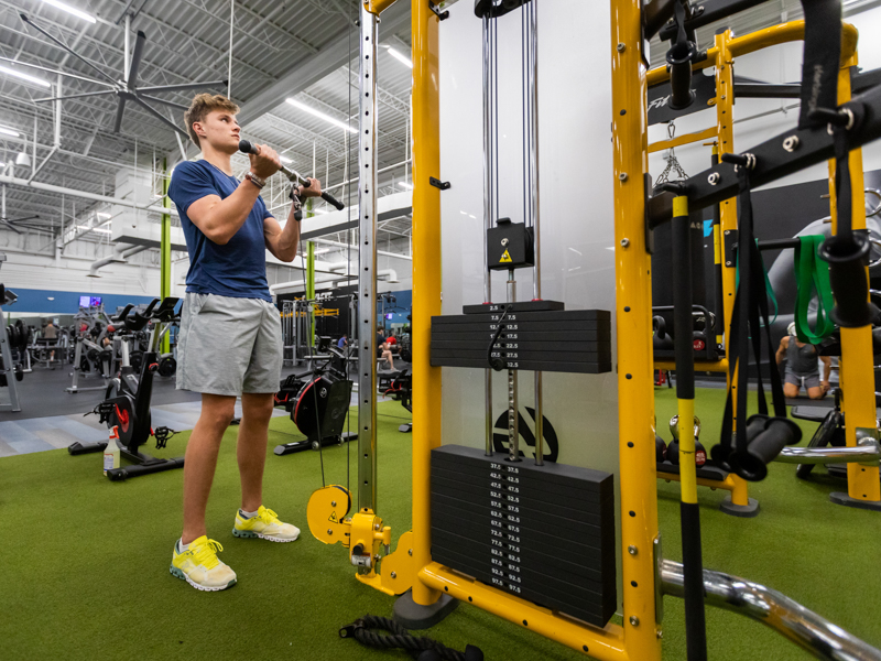 Jack Houston, a junior at Madison Central High School, lifts weights four times a week at Club 4 Fitness in Madison.