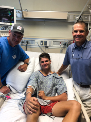 During his hospitalization, Jack Houston got a visit from Madison Central High football coaches.