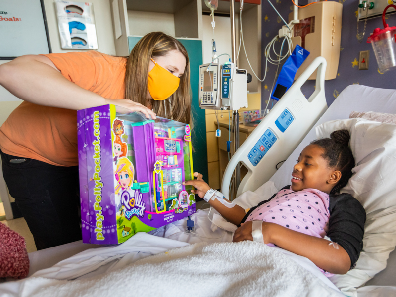 During her stay at Children's of Mississippi, Brooklyn Young of Madison receives a toy from a child life specialist.