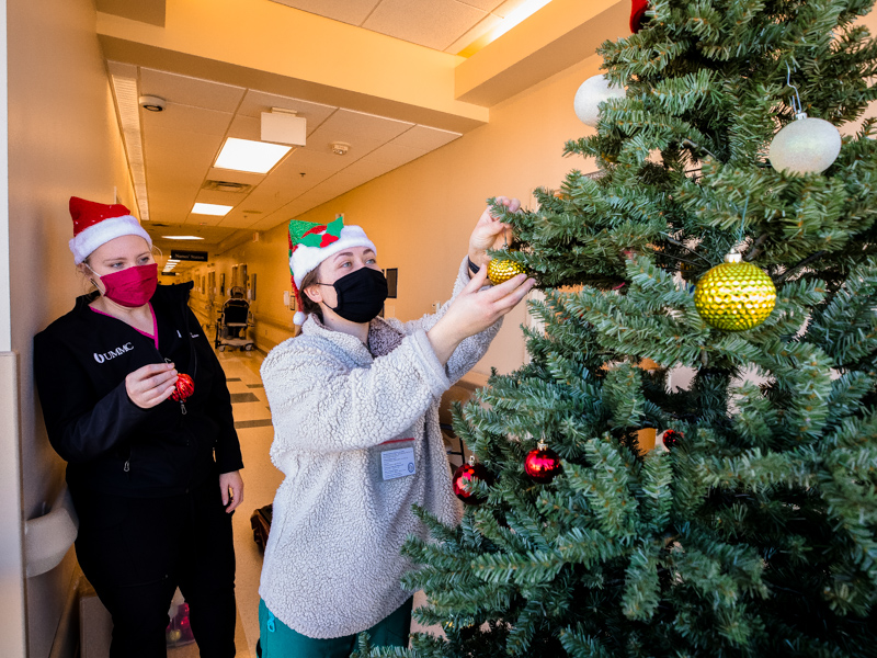 First year medical students Taylor Cupit, left, and Cambria Boone decorate a Christmas tree on 4 South