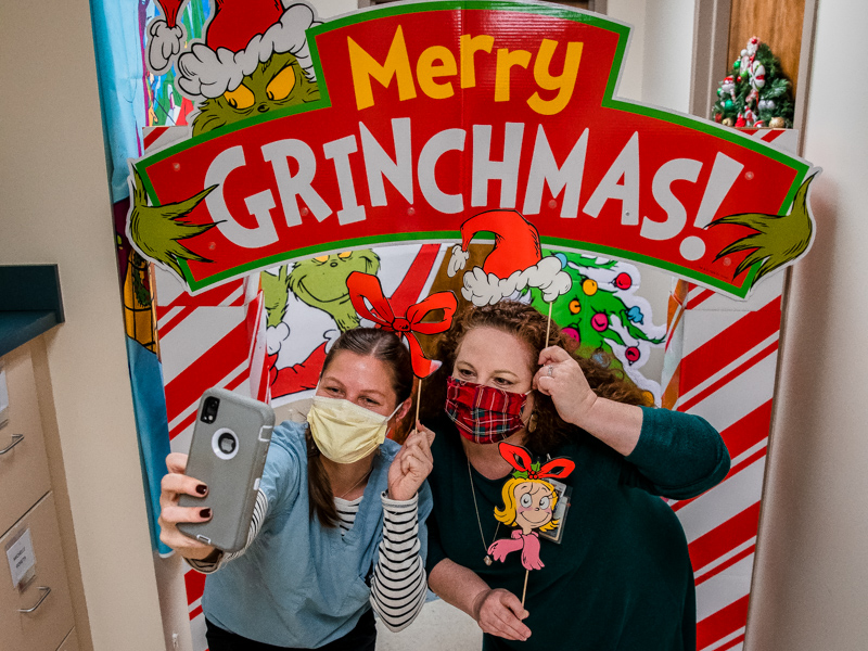 Kelsey Tadlock, left takes a selfie with her pediatric nurse practitioner instructor Michelle Goreth at her Merry Grinchmas decorations in the School of Nursing.