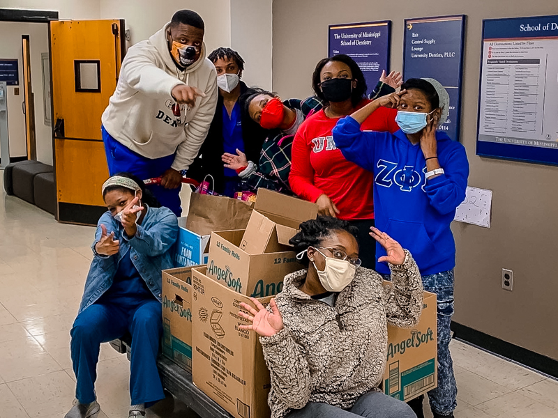 Members of the Student National Dental Association at the School of Dentistry, from left, Ashley Saulsberry, Johntre Goudy, Aaron Winters, Teleshia Johnson, Courtney Jones, Ericka James and SheKerra Dawkins-Strong, held a holiday food drive.