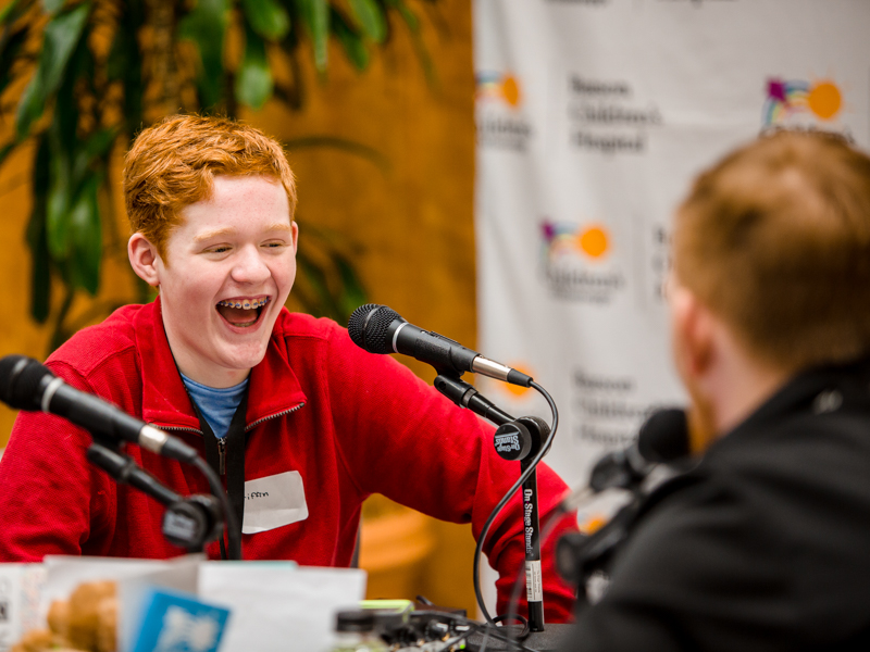 In this photo from the 2020 Mississippi Miracles Radiothon Griffin Threatt of Clinton, a Children's of Mississippi patient, talks with Ryan Johnson of Q101 in Meridian.