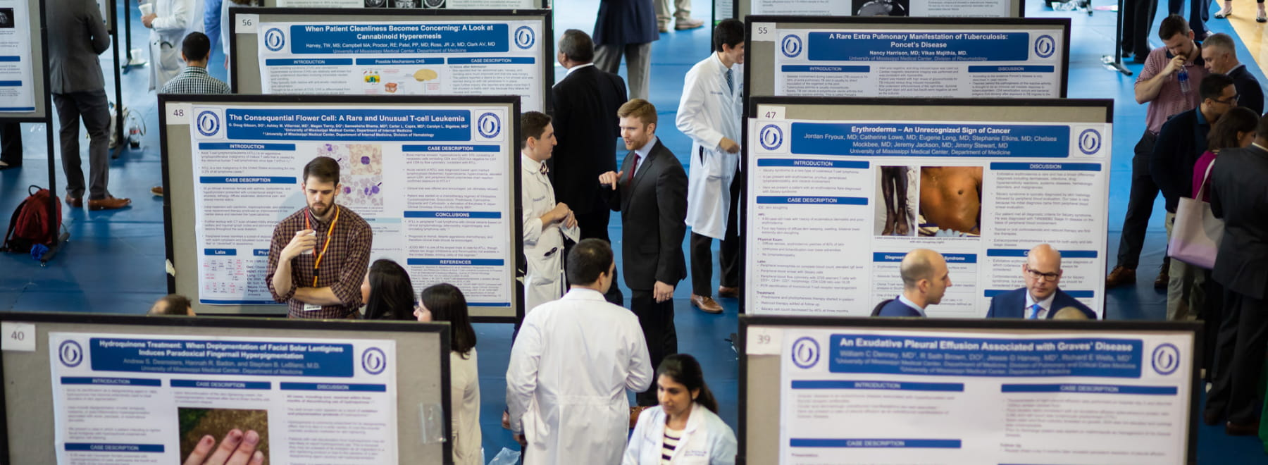 Research day crowd views project boards.