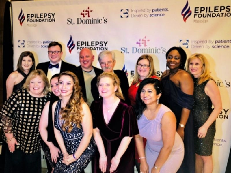 Group of students pose for a picture at the Epilepsy Foundation event.