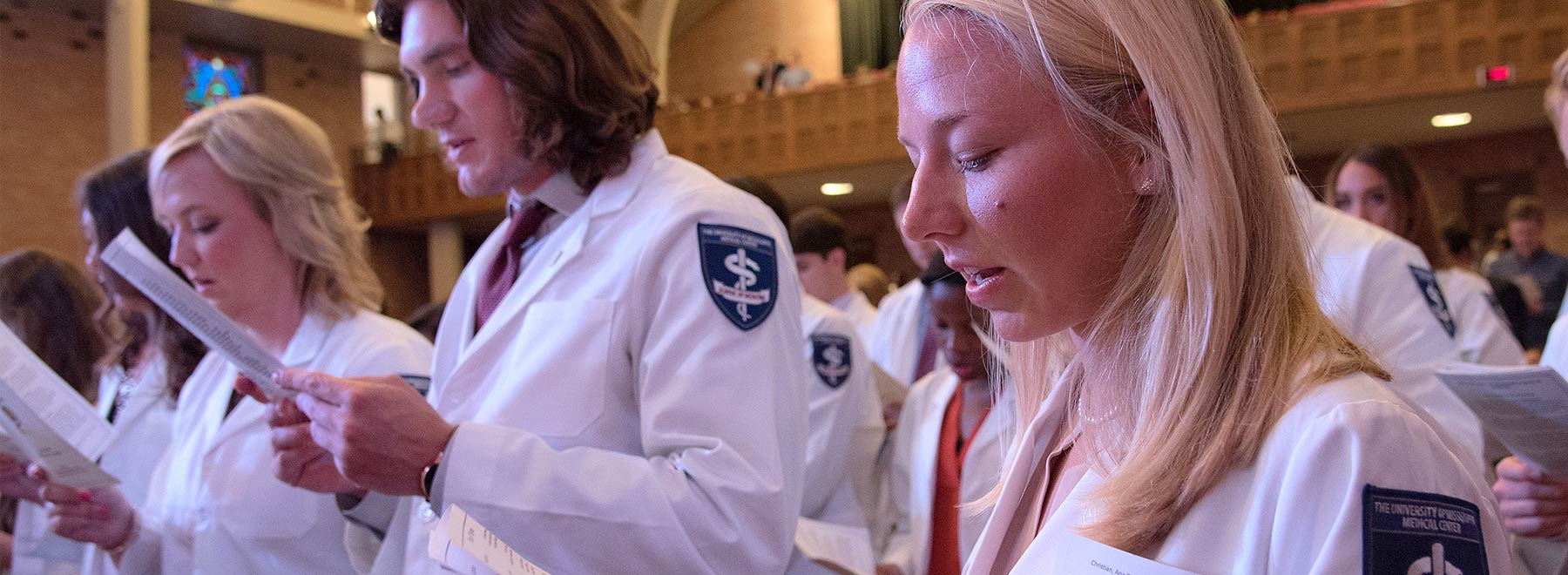 Medical students reciting Hippocratic oath
